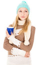 Girl in winter hat with cup Stock Photo