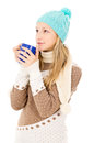 Girl in winter hat with cup Stock Photos