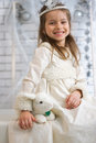Girl in winter holiday dress with toy rabbit a Stock Photos