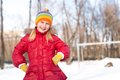 Girl in a winter park actively spending time in winter Stock Image