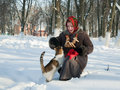 Girl in wintry clothes  plays with cat Stock Photos
