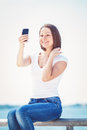 Girl woman looking at cell phone making selfie Royalty Free Stock Photo