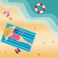 Girl woman lying at beach sand sun tanning wearing hat view from top
