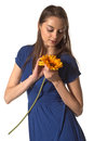 Girl wonders at flower in hands Stock Image