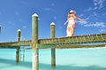 Girl on the wooden jetty making soap bubbles exuma bahamas Royalty Free Stock Photos