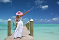 Girl on the wooden jetty making soap bubbles exuma bahamas Stock Photo