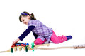 Girl with wooden train little playing a Stock Images