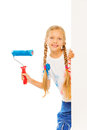 Girl with wool roller stands behind the corner Royalty Free Stock Photo