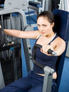 Girl working out in the gym Stock Images