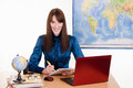 Girl working in a travel agency young beautiful employee the office of the Royalty Free Stock Images