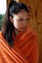 Girl wrapped in a bathrobe room Stock Photos