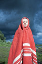 image photo : The girl wrapped in a red blanket