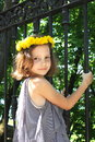Girl in a wreath of dandelion Stock Photography