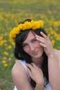 Girl in a wreath from dandelions Royalty Free Stock Photo