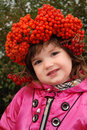 Girl in a wreath from wild ash Stock Photo