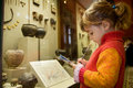 Girl writes to writing-books at excursion Royalty Free Stock Photo