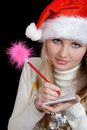 Girl  Writing a Christmas wish list Royalty Free Stock Photography