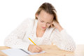 Girl writing in copybook Royalty Free Stock Photo