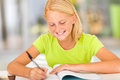 Girl writing homework happy preteen at home Royalty Free Stock Images