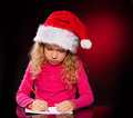 Girl writing a letter Stock Image