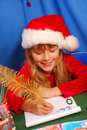 Girl writing a letter to santa Stock Images