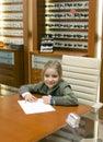 Girl writing at table Royalty Free Stock Photo