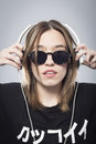 Girl's portrait listening to music with headphones Royalty Free Stock Photo