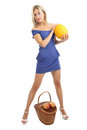 Girl years old in blue skin tight dress with melon young caucasian woman blond hair a short is a full length near the wicker Royalty Free Stock Photography