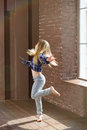Girl years old expressive dancing hair fluttering in jeans Royalty Free Stock Photo