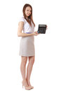 Girl years old shows digits on a calculator full length display portrait of auburn hair gray skirt shirt with short sleeves Stock Photos