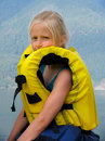 Girl in the yellow air-jacket Royalty Free Stock Photos