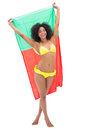 Girl in yellow bikini holding up portugal flag smiling at camera Royalty Free Stock Photo