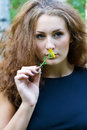 Girl with yellow flower Stock Photos