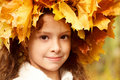 Girl in a yellow head wreath Stock Images