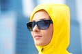 Girl in a yellow hood Stock Photo