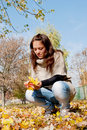 Girl with yellow leaves Stock Images