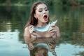 Girl yells at the fish. Royalty Free Stock Photo