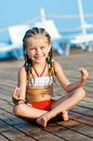 Girl in a yoga pose Stock Image