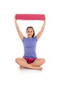 Girl in yoga pose doing a studio Royalty Free Stock Photography