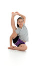 Girl in yoga pose doing a studio Royalty Free Stock Photo