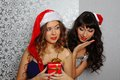 Girlfriends at christmas party Royalty Free Stock Image