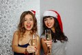 Girlfriends at christmas party Stock Photography