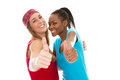Girlfriends of different origin thumbs up africa europe Royalty Free Stock Images