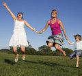 Girlfriends and little boy enjoying sunny summer a Royalty Free Stock Photography