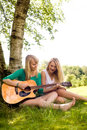 Girlfriends playing with the guitar Royalty Free Stock Image