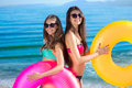 Girlfriends resting on the sea. Royalty Free Stock Photo