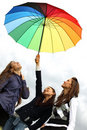 Girlfriends under umbrella Stock Image