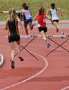 Girls on the 200 meters hurdles Stock Image