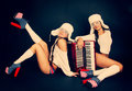 Girls with accordion two an Royalty Free Stock Photos
