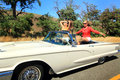Girls adventuring out three attractive pretty happy riding in a convertible with the top down on a country road on an adventure Royalty Free Stock Photo